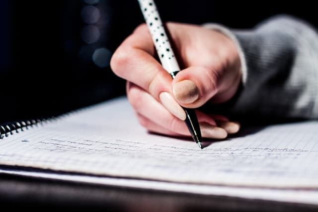 person taking a written test