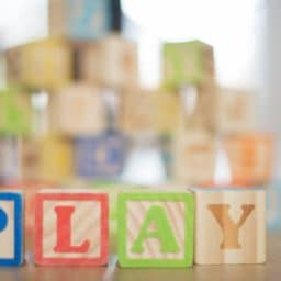 Play spelled out in block letters