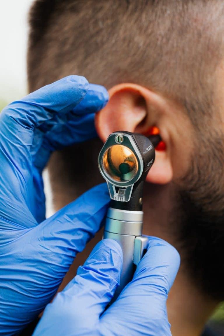 Man getting an ear exam.